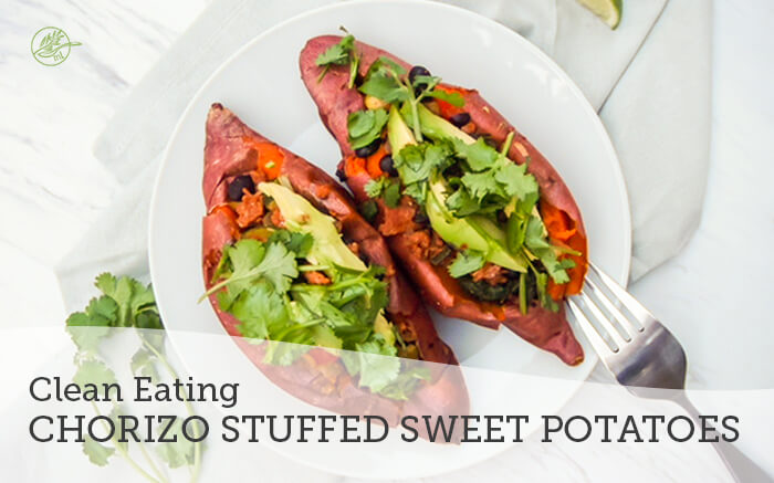 Chorizo stuffed sweet potato recipe on white plate