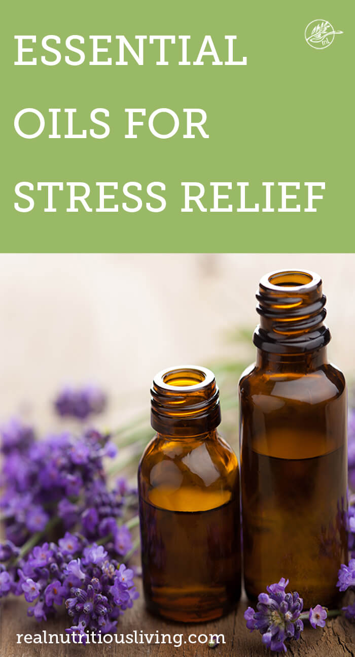 graphic for essential oils for stress relief and lavender flowers on table in background