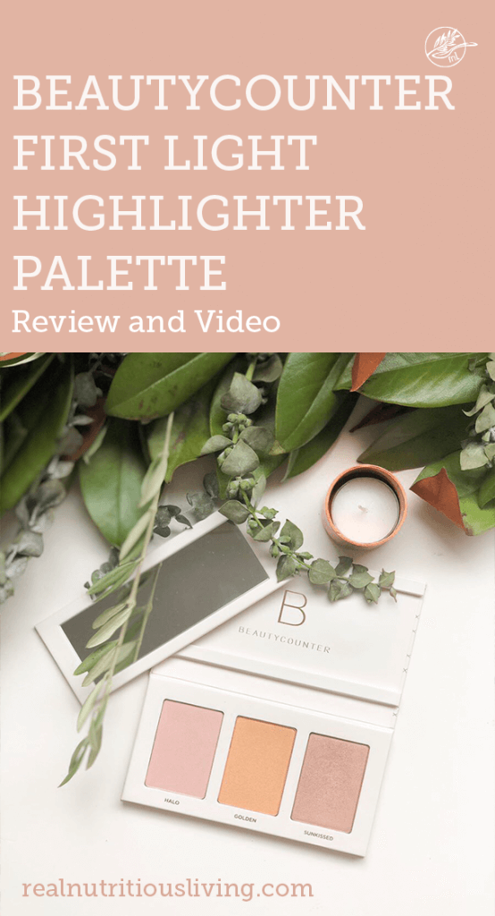 Pin graphic for Beautycounter First Light Highlighter Palette Review and Video with Beautycounter First Light Highlighter Palette open on white table with candle and greenery