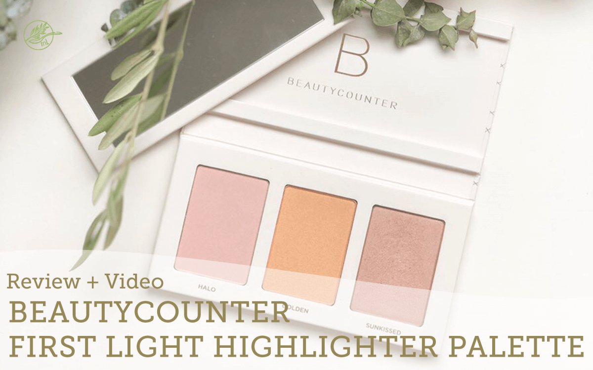 Beautycouunter First Light Highlighter Palette on a white table with greenery and candle