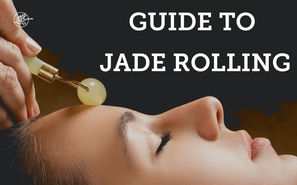woman using a jade roller on her face for guide to jade rolling