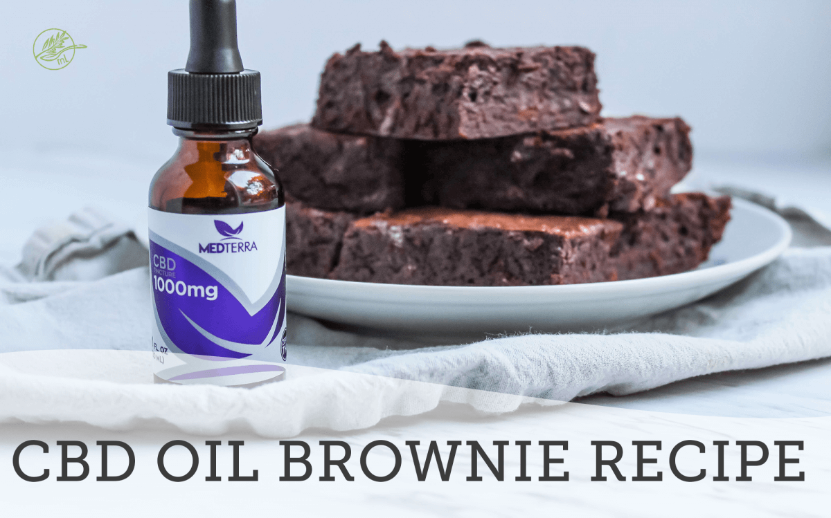 cbd oil in glass bottle with brownies on a white plate in the background